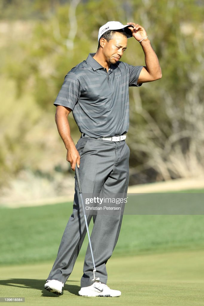 Tiger Woods reacts after losing his match to Nick Watney on the 18th hole during the second round of the World Golf ChampionshipsAccenture Match Play...