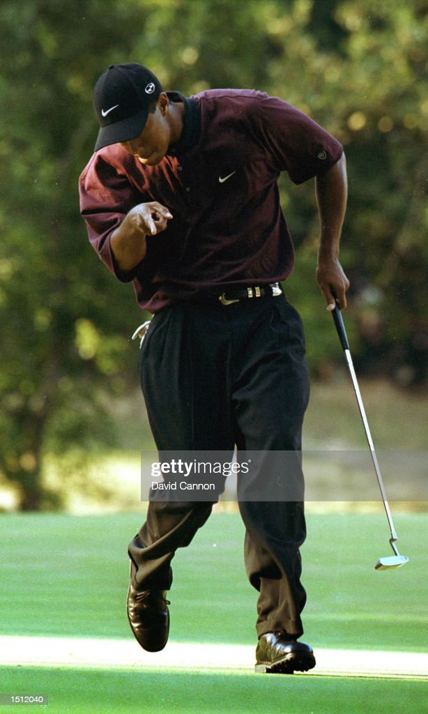 Tiger Woods reacts after making a putt on the first hole of the playoff August 20 2000 during the PGA Championship at the Valhalla Golf Club in...