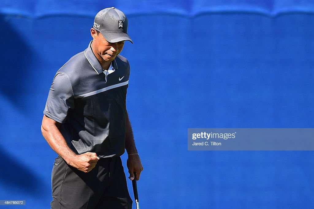 Tiger Woods reacts after making an eagle putt on the 15th green during the second round of the Wyndham Championship at Sedgefield Country Club on August 21, 2015 in Greensboro, North Carolina.