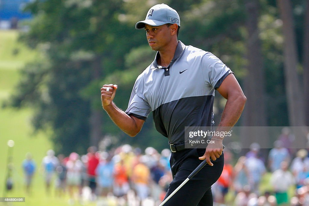 Tiger Woods reacts after making his par putt on the 10th hole during the third round of the Wyndham Championship at Sedgefield Country Club on August 22, 2015 in Greensboro, North Carolina.