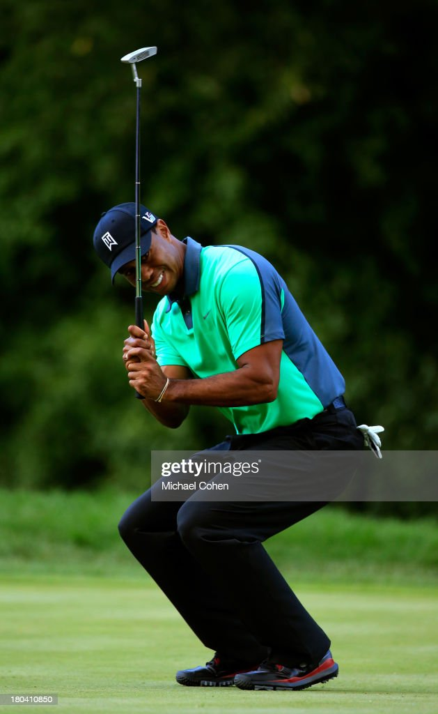 <a gi-track='captionPersonalityLinkClicked' href=/galleries/search?phrase=Tiger+Woods&family=editorial&specificpeople=157537 ng-click='$event.stopPropagation()'>Tiger Woods</a> reacts after missing a putt on the sixth green during the First Round of the BMW Championship at Conway Farms Golf Club on September 12, 2013 in Lake Forest, Illinois.