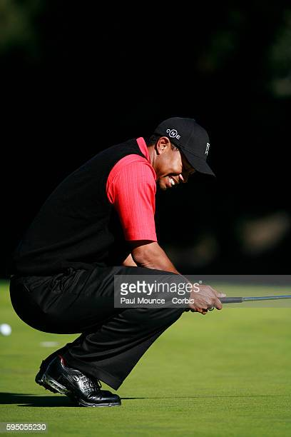 Tiger Woods reacts after missing his putt on the 5th hole during the final round at the Target World Challenge PGA golf Tournament held at the...
