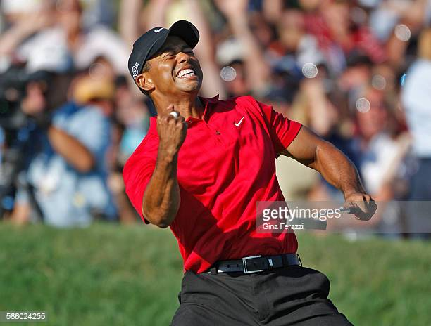 Tiger Woods reacts as he sinks a birdie putt on the 18th hole to force a playoff with Rocco Mediate during the final round of the US Open at Torrey...