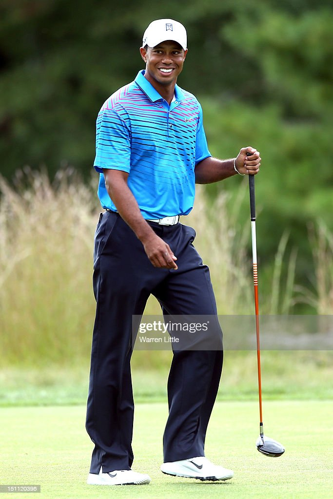 <a gi-track='captionPersonalityLinkClicked' href=/galleries/search?phrase=Tiger+Woods&family=editorial&specificpeople=157537 ng-click='$event.stopPropagation()'>Tiger Woods</a> reacts during the second round of the Deutsche Bank Championship at TPC Boston on September 1, 2012 in Norton, Massachusetts.