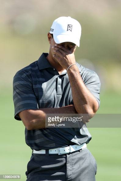 Tiger Woods reacts on the second hole during the second round of the World Golf ChampionshipsAccenture Match Play Championship at the RitzCarlton...