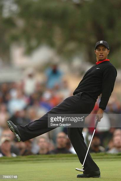 Tiger Woods reacts to a missed eagle putt on the 13th hole during fourth round play on the south course at the Buick Invitational golf tournament at...