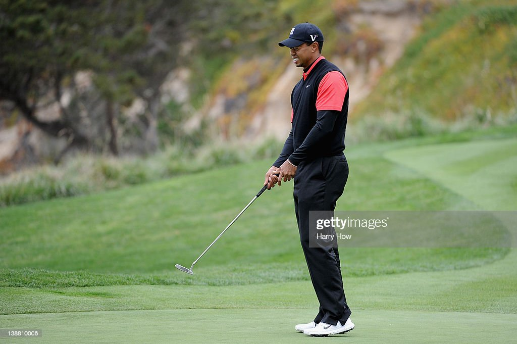 Tiger Woods reacts to a missed putt on the fifth hole during the final round of the AT&T Pebble Beach National Pro-Am at Pebble Beach Golf Links on February 12, 2012 in Pebble Beach, California.