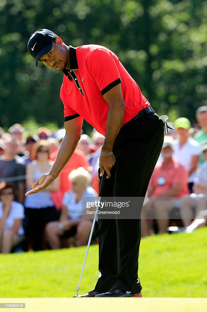 Tiger Woods reacts to a putt on the 15th green during the Final Round of the World Golf Championships-Bridgestone Invitational at Firestone Country Club South Course on August 4, 2013 in Akron, Ohio.