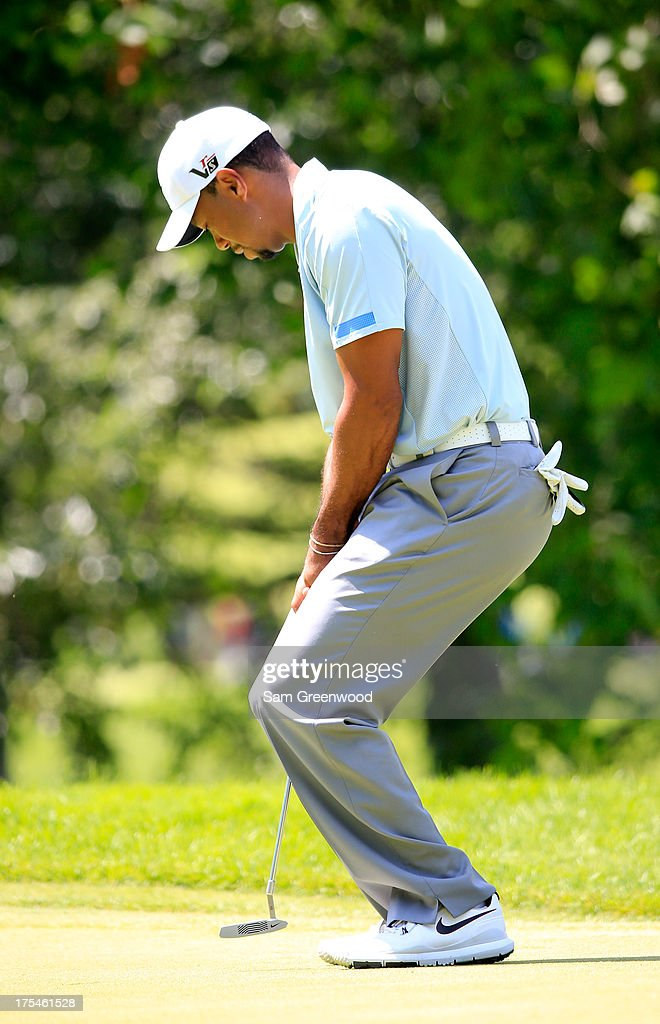 Tiger Woods reacts to his putt on the fifth green during the Third Round of the World Golf Championships-Bridgestone Invitational at Firestone Country Club South Course on August 3, 2013 in Akron, Ohio.