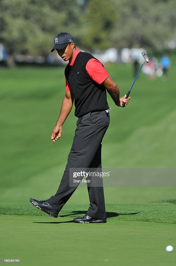 Tiger Woods reacts to his putt on the ninth hole during the final round of the Farmers Insurance Open at Torrey Pines Golf Course on January 28, 2013 in La Jolla, California.