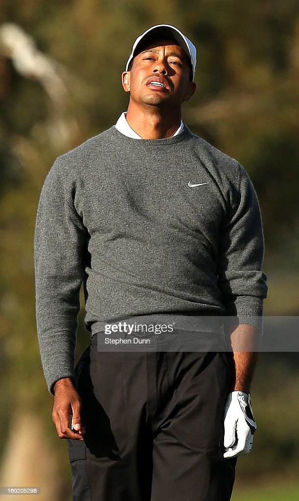 Tiger Woods reacts to his tee shot on the second hole during the final round of the Farmers Insurance Open on the South Course at Torrey Pines Golf Course on January 27, 2013 in La Jolla, California.
