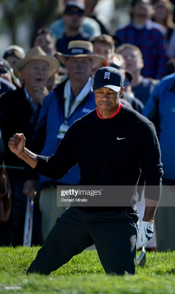 Tiger Woods reacts to hitting out of the 11th green bunker en route to his -14 under victory during the Final Round at the Farmers Insurance Open at Torrey Pines Golf Course on January 28, 2013 in La Jolla, California.