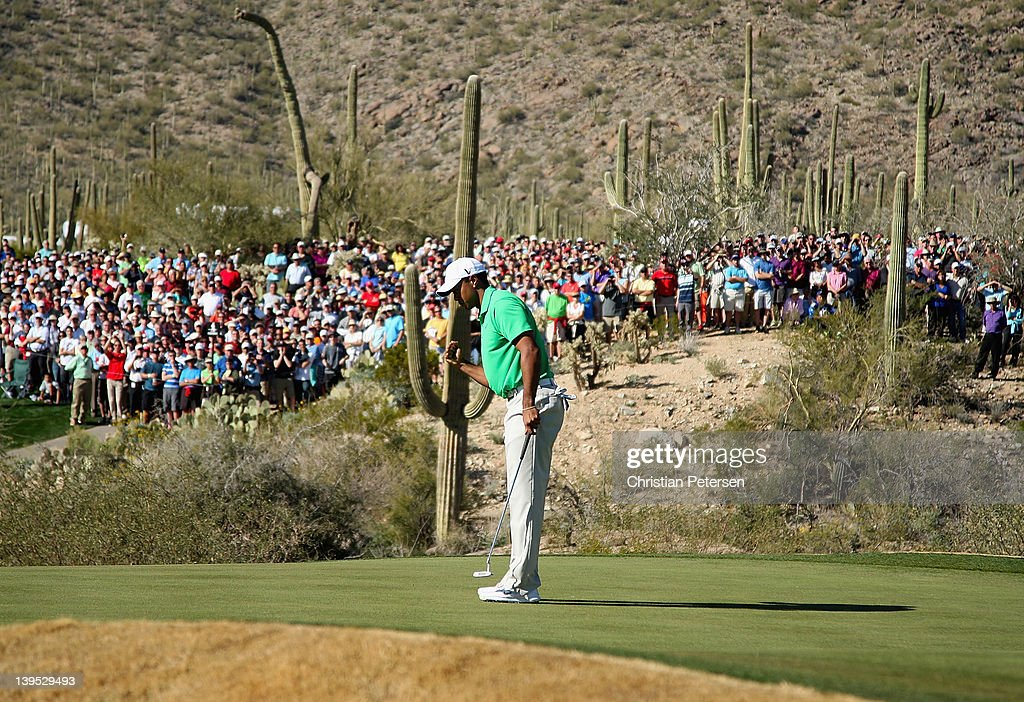 Tiger Woods reacts to sinking his putt on the 18th hole to win his match against Gonzalo FernandezCastano of Spain during the first round of the...