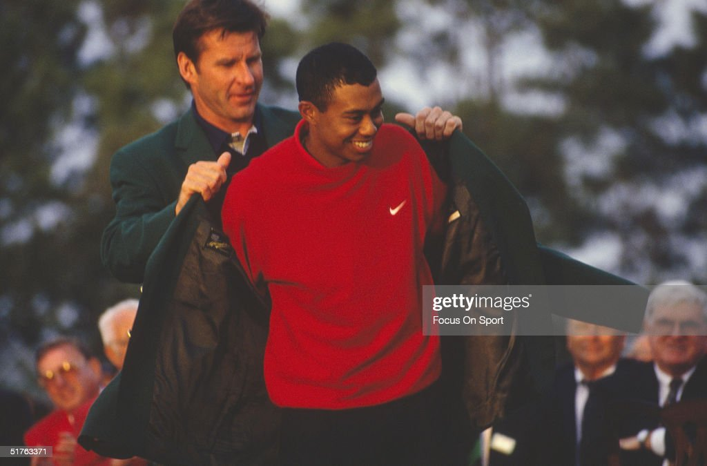 Tiger Woods recieves his Green Jacket for winning the Masters Tournament at the Augusta National Golf Club on April 13, 1997 in Augusta, Georgia. Tiger Woods won the Masters with a 18 under par.