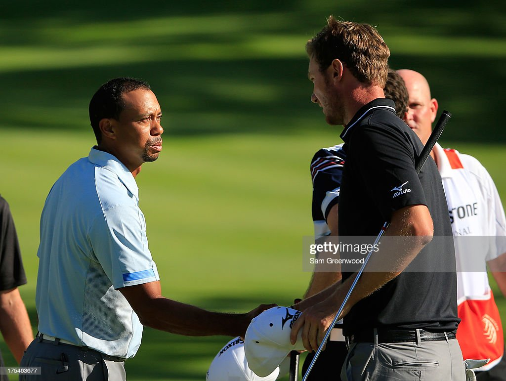 <a gi-track='captionPersonalityLinkClicked' href=/galleries/search?phrase=Tiger+Woods&family=editorial&specificpeople=157537 ng-click='$event.stopPropagation()'>Tiger Woods</a> (L) shakes hands with Chris Wood of England during the Third Round of the World Golf Championships-Bridgestone Invitational at Firestone Country Club South Course on August 3, 2013 in Akron, Ohio.