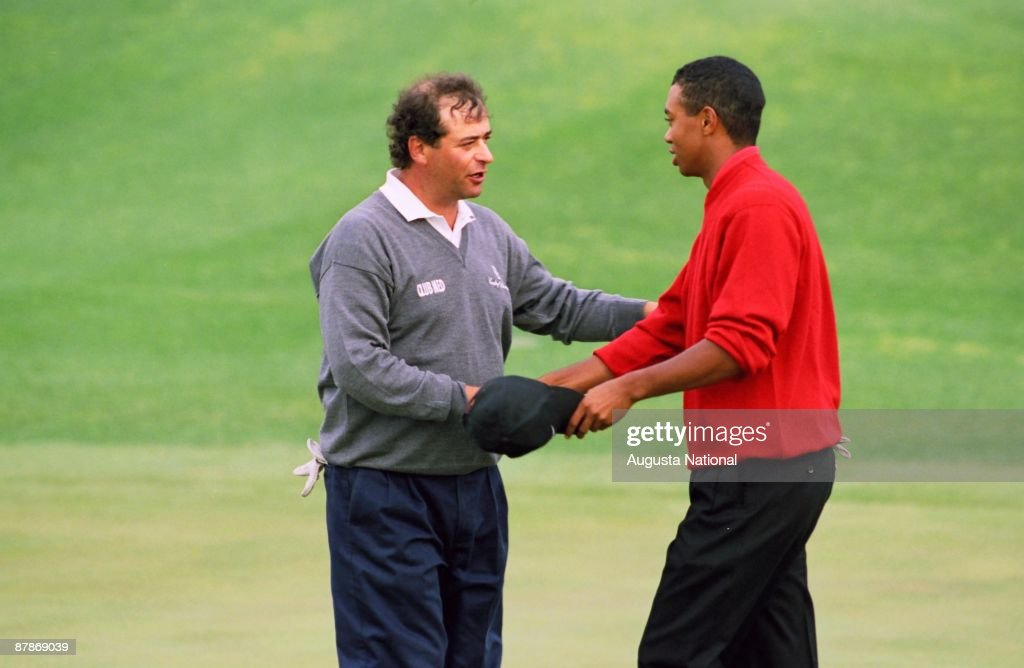 Tiger Woods shakes hands with Costantino Rocca after winning the 1997 Masters Tournament at Augusta National Golf Club on April 13, 1997 in Augusta, Georgia.