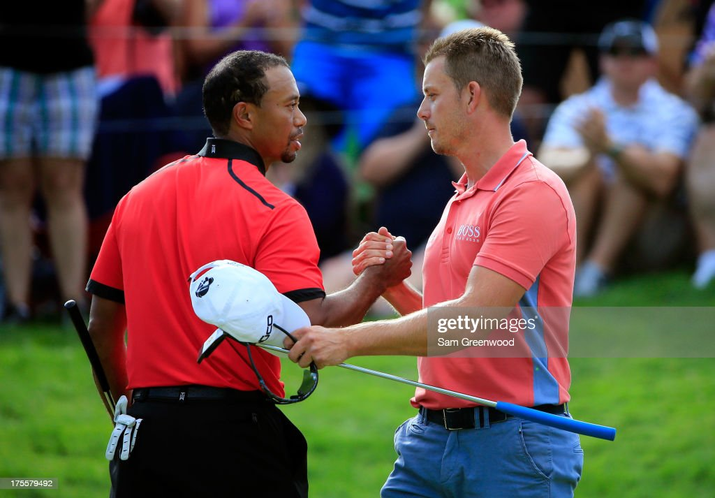 Tiger Woods (L) shakes hands with Henrik Stenson of Sweden after the Final Round of the World Golf Championships-Bridgestone Invitational at Firestone Country Club South Course on August 4, 2013 in Akron, Ohio. Woods won the tournament with a score of -15.