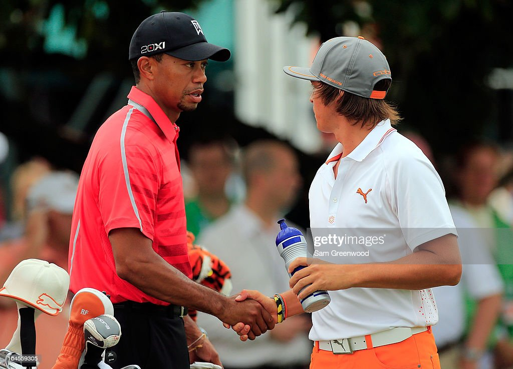 Tiger Woods (L) shakes hands with Rickie Folwer on the 1st hole during the final round of the Arnold Palmer Invitational presented by MasterCard at the Bay Hill Club and Lodge on March 24, 2013 in Orlando, Florida.