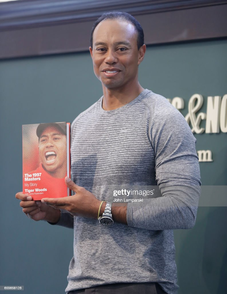 Tiger Woods signs copies of his new book 'The 1997 Masters: My Story' at Barnes & Noble Union Square on March 20, 2017 in New York City.