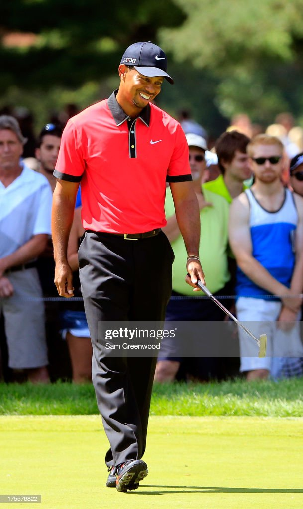 <a gi-track='captionPersonalityLinkClicked' href=/galleries/search?phrase=Tiger+Woods&family=editorial&specificpeople=157537 ng-click='$event.stopPropagation()'>Tiger Woods</a> smiles after a putt on the sixth green during the Final Round of the World Golf Championships-Bridgestone Invitational at Firestone Country Club South Course on August 4, 2013 in Akron, Ohio.