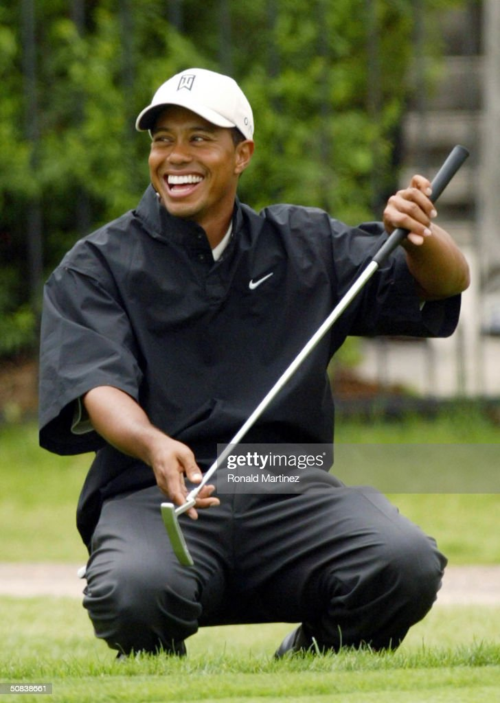 Tiger Woods smiles after John Cook made a long putt on the 18th hole during the second round of the EDS Byron Nelson Championship on May 14 2004 on...