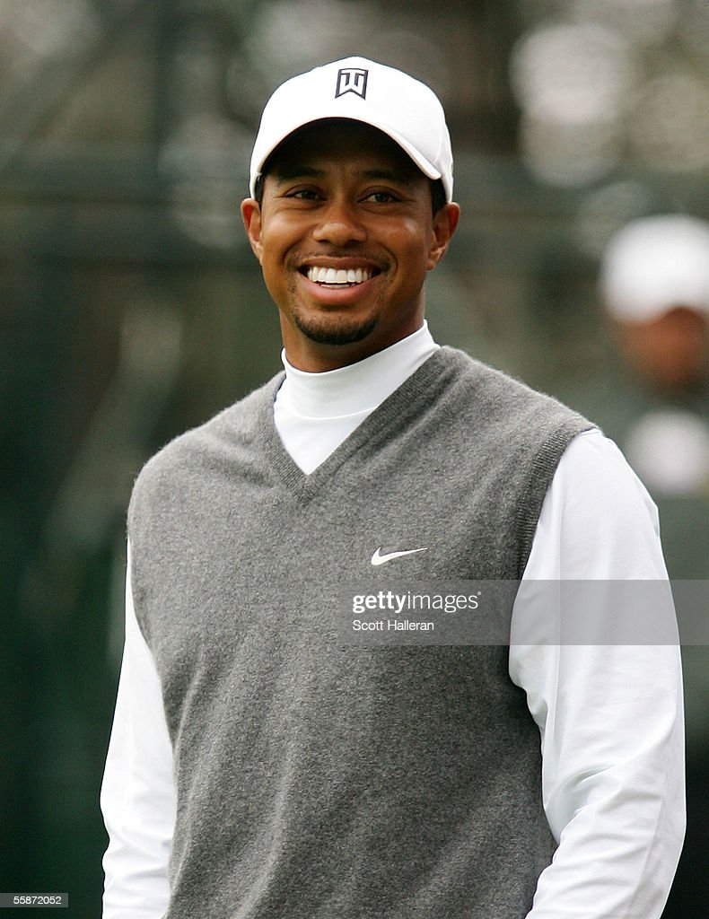 Tiger Woods smiles after making an eagle putt on the parfour seventh hole during the second round of the WGC American Express Championship at Harding...