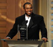 Tiger Woods smiles as he accepts his Outstanding Achievement Award 12 December 2000 at the Sports Illustrated Sportsman of the Year Awards in New...