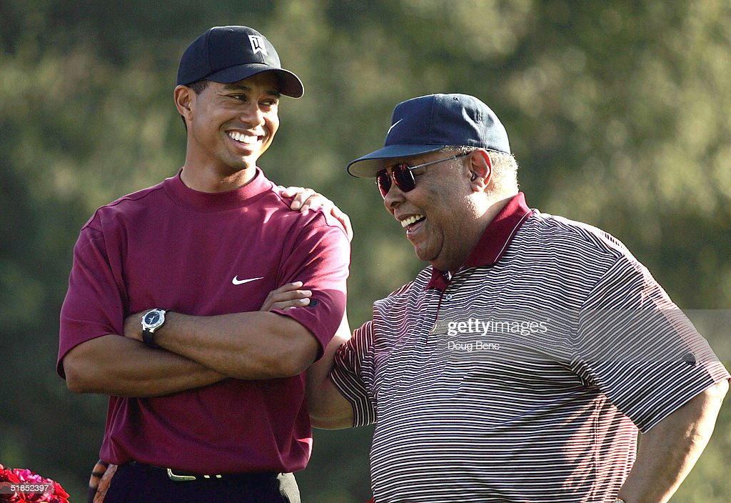 Tiger Woods (L) smiles as he stands with his father, Earl Woods, during the trophy presentation of the Target World Challenge on December 12, 2004 at Sherwood Country Club in Thousand Oaks, California. Woods won the event at 16 under par.