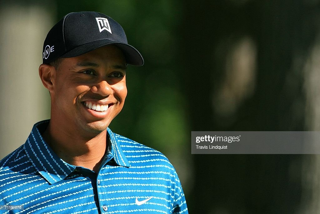 Tiger Woods smiles as he walks off a tee during the Tuesday practice round for the 2006 US Open Championship at Winged Foot Golf Club on June 13 2006...