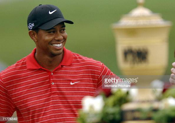 Tiger Woods smiles at the crowd after winning the Bridgestone Invitational at Firestone Country Club August 27 2006 in Akron Ohio