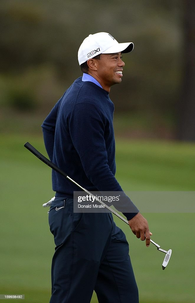 Tiger Woods smiles on the green during the Pro-Am at the Farmers Insurance Open at Torrey Pines North Golf Course on January 23, 2013 in La Jolla, California.
