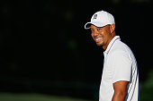 Tiger Woods smiles on the practice ground during the proam prior to the start of the Hero World Challenge at the Isleworth Golf Country Club on...