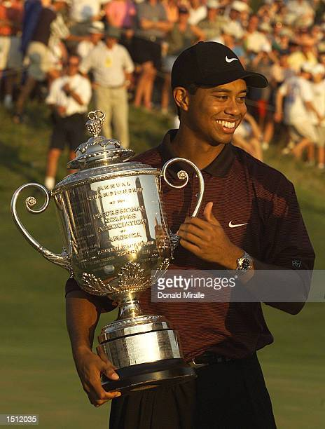 Tiger Woods smiles while holding the Wanamaker Trophy August 20 2000 after winning the PGA Championship over Bob May in a threehole playoff at the...
