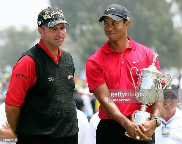 Tiger Woods stands with runnerup Rocco Mediate after winning on the first sudden death playoff hole during the playoff round of the 108th US Open at...