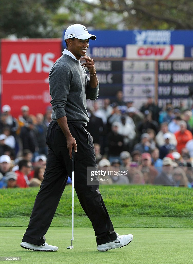 Tiger Woods studies his putt on the 17th hole during the third round of the Farmers Insurance Open at Torrey Pines Golf Course on January 27, 2013 in La Jolla, California.
