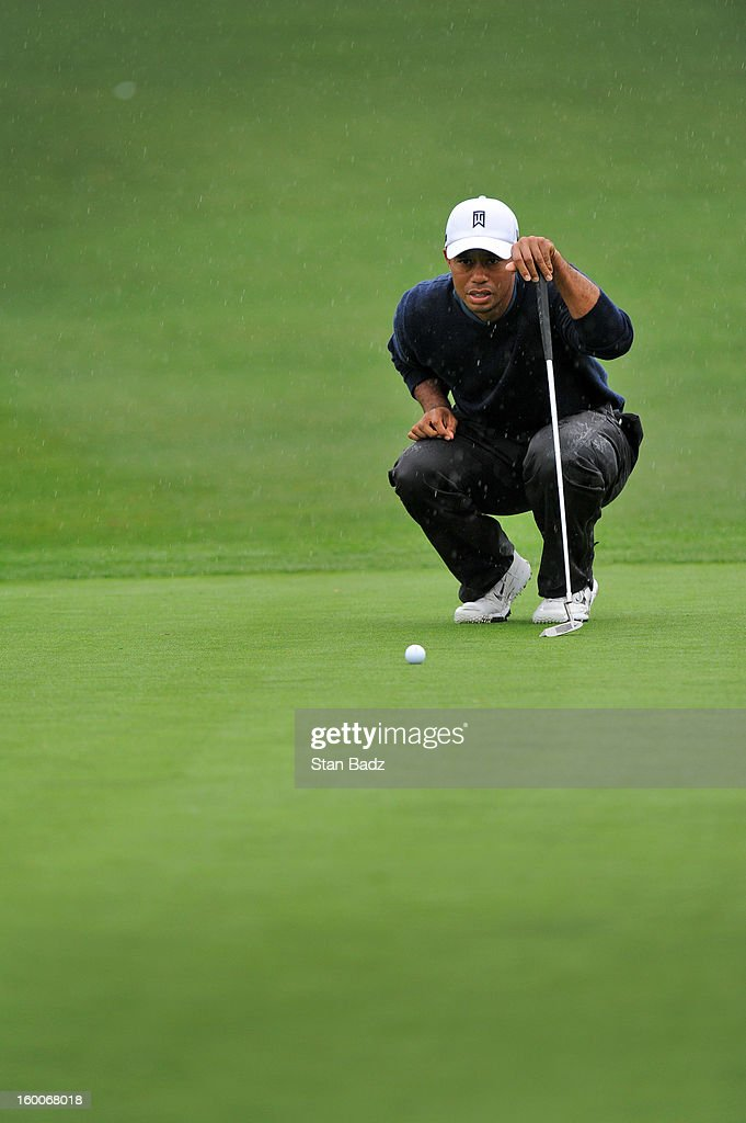 Tiger Woods studies his putt on the ninth hole during the second round of the Farmers Insurance Open at Torrey Pines Golf Course on January 25, 2013 in La Jolla, California.