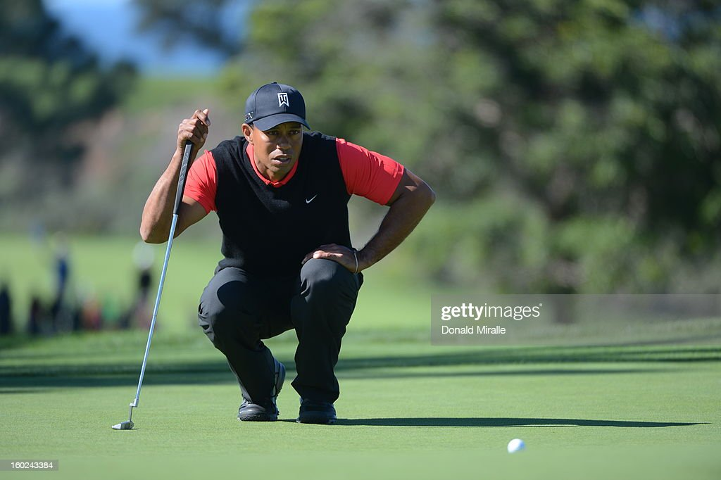 Tiger Woods studies the 8th green during the Final Round at the Farmers Insurance Open at Torrey Pines Golf Course on January 28, 2013 in La Jolla, California.