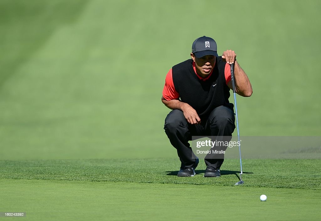 Tiger Woods studies the 9th green during the Final Round at the Farmers Insurance Open at Torrey Pines Golf Course on January 28, 2013 in La Jolla, California.