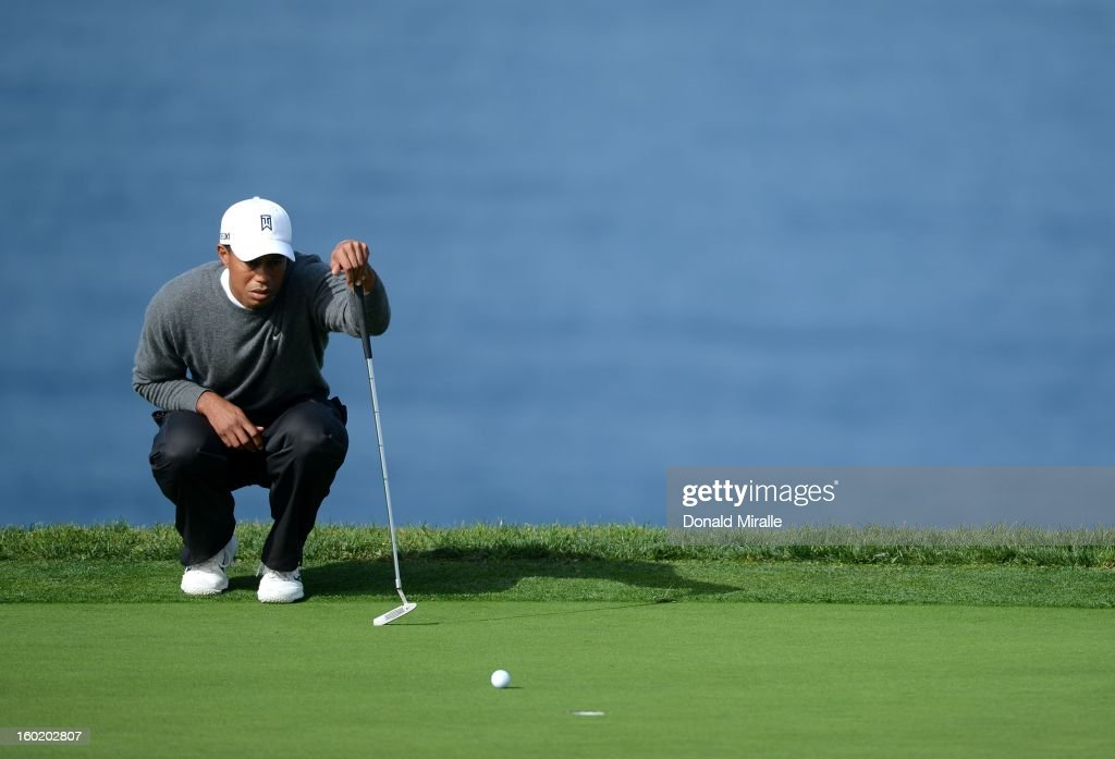 Tiger Woods studies the green during the Third Round at the Farmers Insurance Open at Torrey Pines South Golf Course on January 27, 2013 in La Jolla, California.