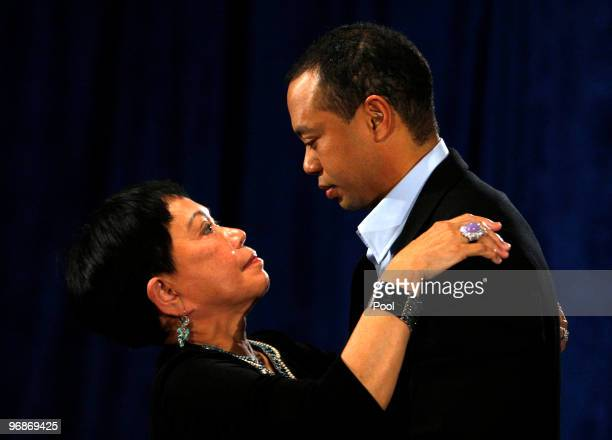 Tiger Woods talks his mother Kultida following a statement from the Sunset Room on the second floor of the TPC Sawgrass home of the PGA Tour on...