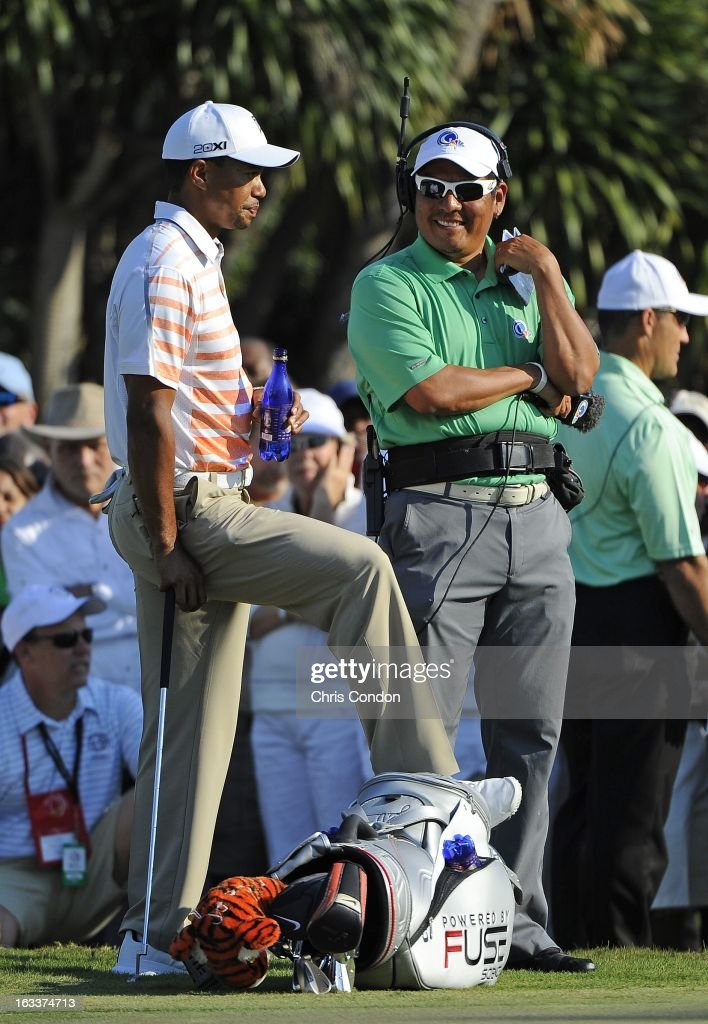 Tiger Woods talks to Notah Begay III on the 13th hole during the second round of the World Golf Championships-Cadillac Championship at TPC Blue Monster at Doral on March 8, 2013 in Doral, Florida.