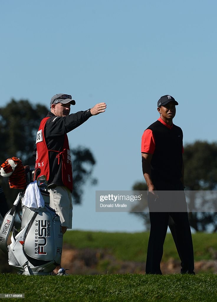 Tiger Woods talks with his caddie Joe LaCava about the 8th hole during the Final Round at the Farmers Insurance Open at Torrey Pines Golf Course on January 28, 2013 in La Jolla, California.
