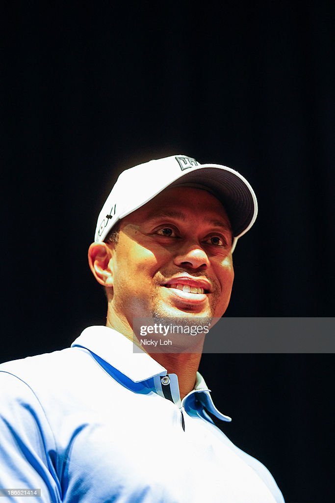 <a gi-track='captionPersonalityLinkClicked' href=/galleries/search?phrase=Tiger+Woods&family=editorial&specificpeople=157537 ng-click='$event.stopPropagation()'>Tiger Woods</a> teaches a golf class at the Marina Bay Sands on November 1, 2013 in Singapore. The session was held on the custom-made golf course with student athletes from the Singapore Sports School, Golf Academy and the Dyslexia Association of Singapore.