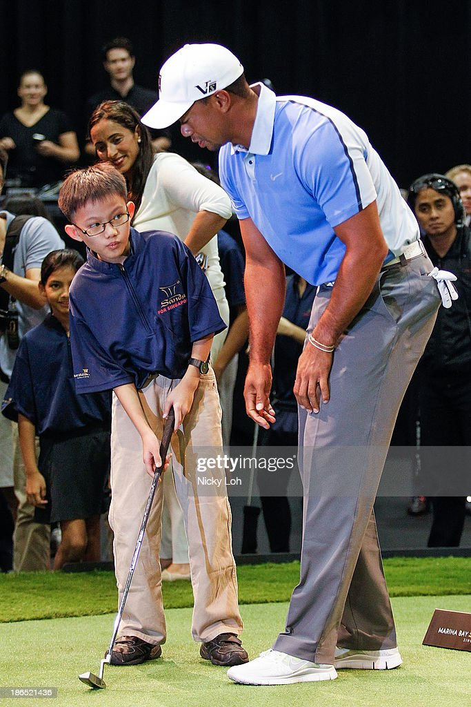 Tiger Woods teaches a golf class at the Marina Bay Sands on November 1, 2013 in Singapore. The session was held on the custom-made golf course with student athletes from the Singapore Sports School, Golf Academy and the Dyslexia Association of Singapore.