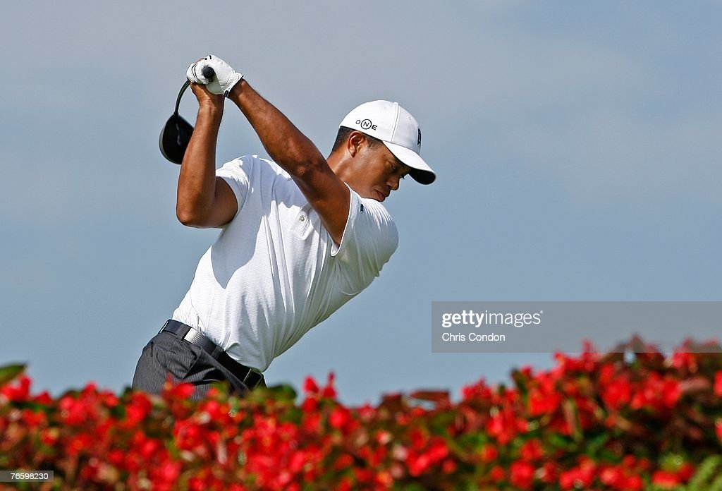 Tiger Woods Tees off on the 11th hole during the third round of BMW Championship the third event of the new PGA TOUR Playoffs for the FedExCup at Cog...