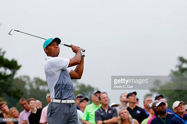 Tiger Woods tees off on the 16th hole during the first round of the Wyndham Championship at Sedgefield Country Club on August 20 2015 in Greensboro...