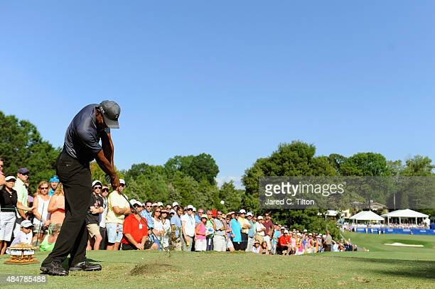 Tiger Woods tees off on the 16th hole during the second round of the Wyndham Championship at Sedgefield Country Club on August 21 2015 in Greensboro...