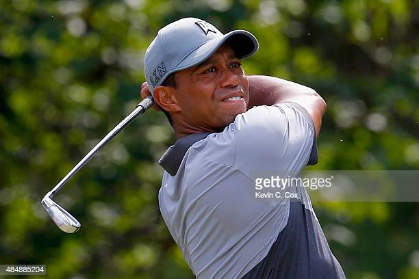 Tiger Woods tees off on the eighth hole during the third round of the Wyndham Championship at Sedgefield Country Club on August 22 2015 in Greensboro...