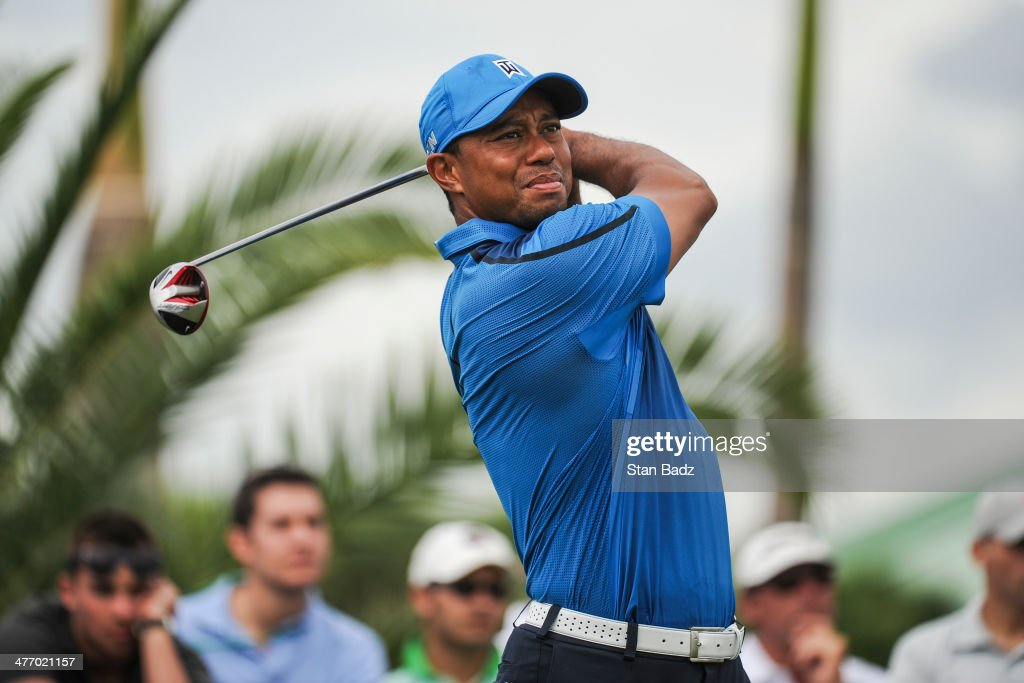 <a gi-track='captionPersonalityLinkClicked' href=/galleries/search?phrase=Tiger+Woods&family=editorial&specificpeople=157537 ng-click='$event.stopPropagation()'>Tiger Woods</a> tees off on the fifth hole during the first round of the World Golf Championships-Cadillac Championship at Blue Monster, Trump National Doral, on March 6, 2014 in Doral, Florida.