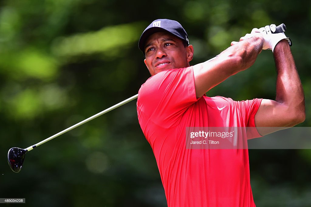 <a gi-track='captionPersonalityLinkClicked' href=/galleries/search?phrase=Tiger+Woods&family=editorial&specificpeople=157537 ng-click='$event.stopPropagation()'>Tiger Woods</a> tees off on the second hole during the final round of the Wyndham Championship at Sedgefield Country Club on August 23, 2015 in Greensboro, North Carolina.